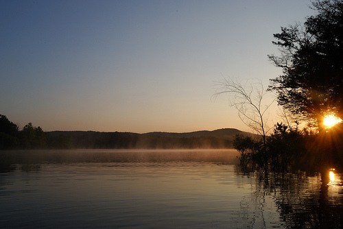 Mist on the water of Table Rock Lake as the sun rises at our campsite at Big Bay Recreation Area in the Mark Twain National Forest.