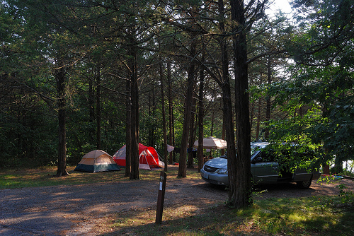 A van and two tents at a family campsite at Big Bay Recreation Area on Table Rock Lake.