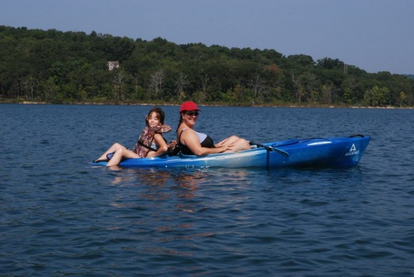 Photograph of Ginger Davis Allman and Lanie trying out Ginger's D10 kayak August 2010.