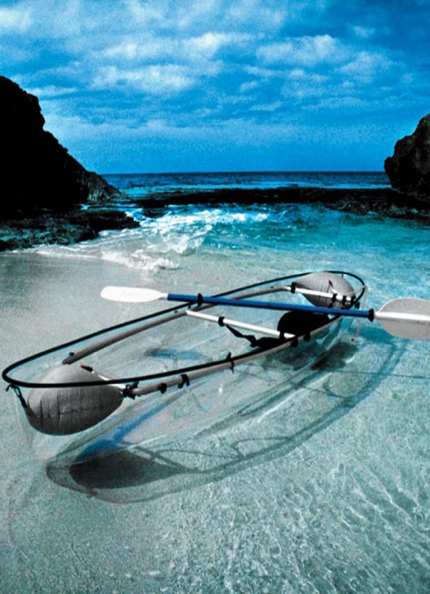 A transparent kayak on a tropical beach - hardly the Ozarks!